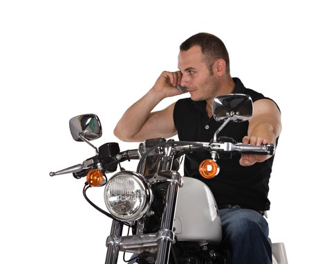 man with short hair talking on the phone and riding a bike, isolated on white photo