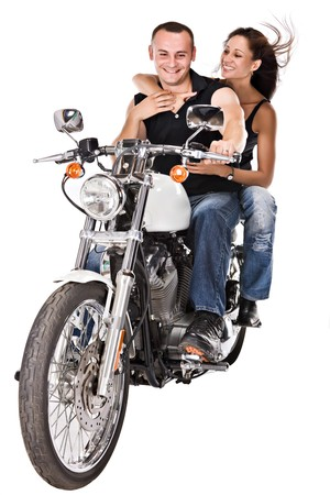 couple riding a bike caucasian man with woman with long hair  写真素材