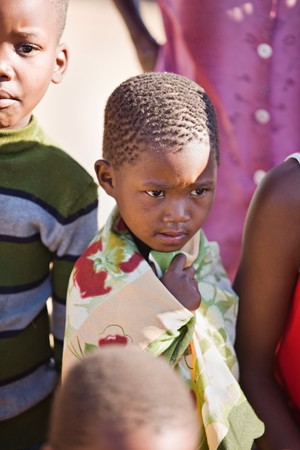 poor community of african kids in a village