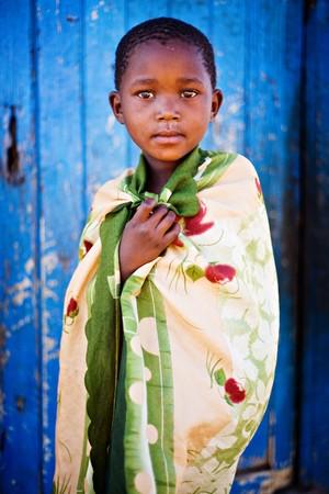 kalahari desert: african boy living in a very poor community in a village near Kalahari desert
