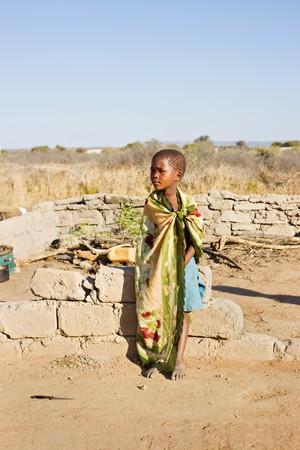 apartheid: african boy living in a very poor community in a village near Kalahari desert