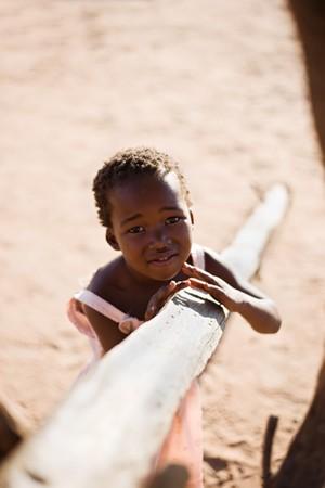 african girl living in a very poor community in a village near Kalahari desert 写真素材