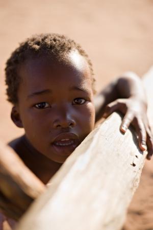 child poverty: Portrait of poor African child, location Mmankodi village, Botswana