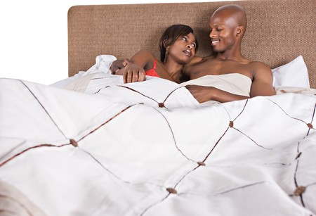 bed sheet: african american couple in bed having fun