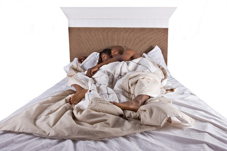 african american couple in bed sleeping Stock Photo