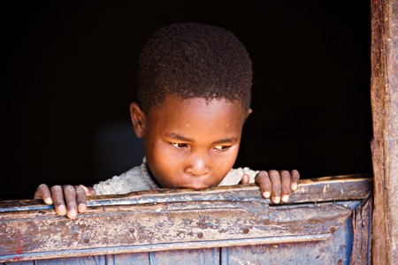 needy: Portrait of poor African child, location Mmankodi village, Botswana