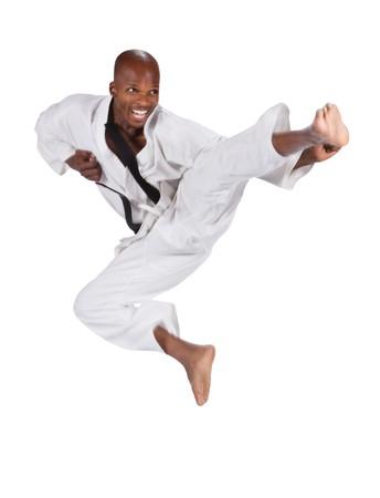 african american man in karate suit, suspended in mid air