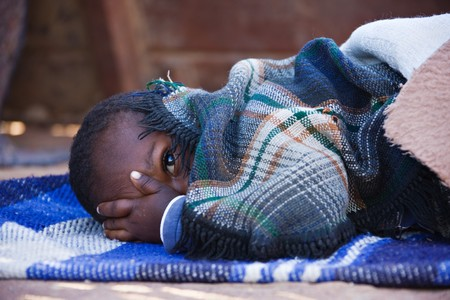 needy: Portrait of African child sleeping in the yard , location Mmankodi village , Botswana Stock Photo