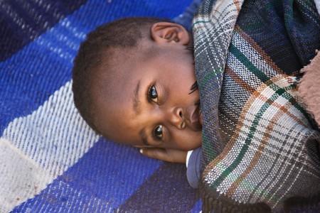 Portrait of African child sleeping in the yard, location Mmankodi village , Botswana Stock Photo