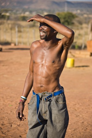 harsh: Adult African man protecting his eyes of the harsh sun Stock Photo