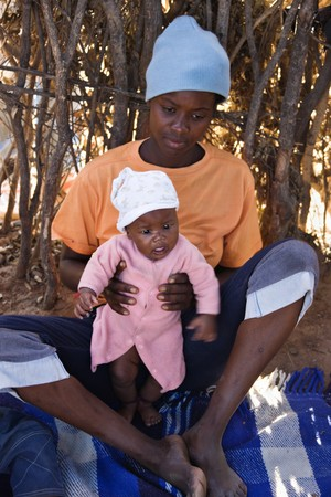 Portrait of African child and mother in the hut, location Mmankodi village, Botswana photo