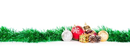 tinsel: tinsel and globes, decorations for Christmas, isolated on white background