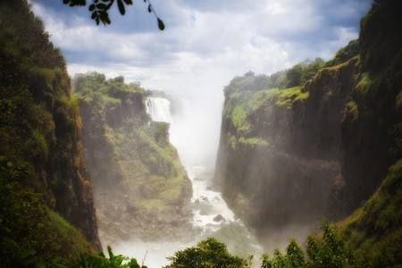 Victoria Falls, on Zambezi River, Zimbabwe border with Zambia and Botswana  Mosi-oa-Tunya the Mist that Thunders, HDR tone mapping and soft  focus 写真素材