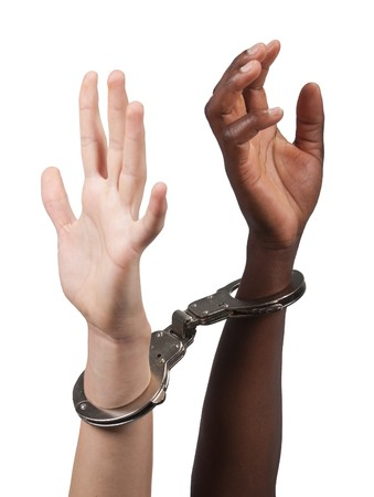 Caucasian man and African American woman handcuffed together Stock Photo - 6931081