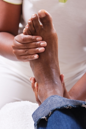 adult's feet: lifestyle, African American man having a foot massage