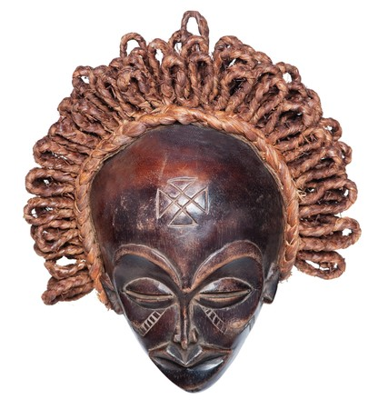 woooden vintage african mask with raffia hair photo