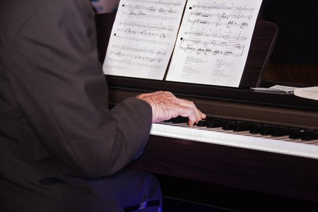 piano player: old caucasian man playing the piano, musical notes in the background