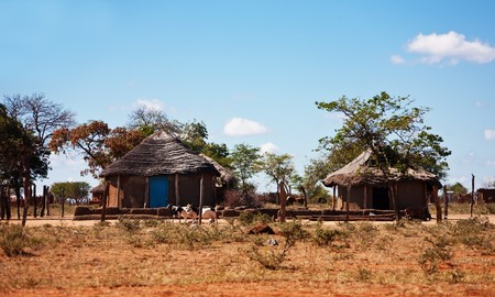 world village: typical household from Southern Africa,Botswana, SouthAfrica, rondaveles with thatched roof Stock Photo