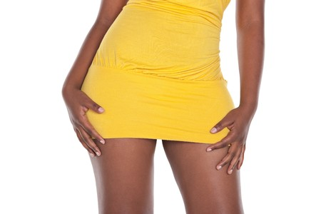 simple yellow mini dress on an African girl body, waist and hips. photo