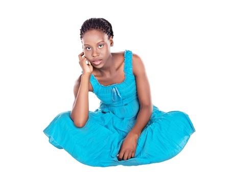 sitting african woman with blue dress, isolated on white photo