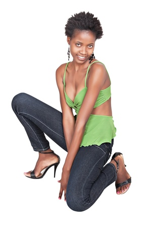mature women only: standing african girl with jeans, isolated on white