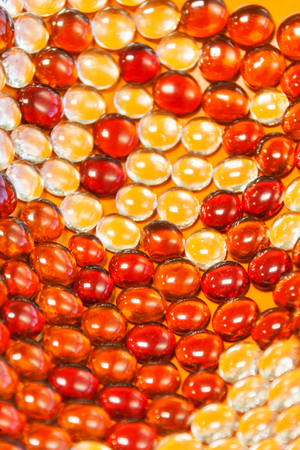 Big Glass Beads Background red and orange in a convex shape