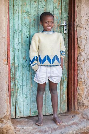 african Motswana child sitting in the door of the shack Stock fotó