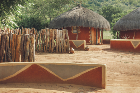 Traditional round African houses with thatched roof Stok Fotoğraf