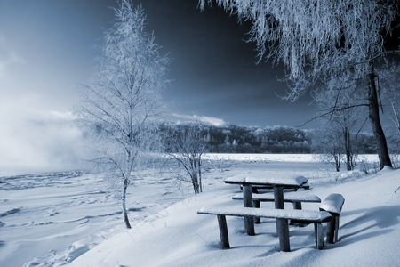Little table and bench on coast of the river Stock Photo - 1470105