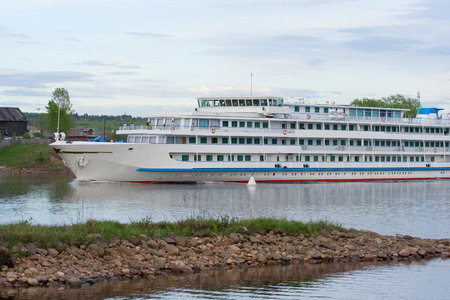 The big tourist ship is floating on the river photo