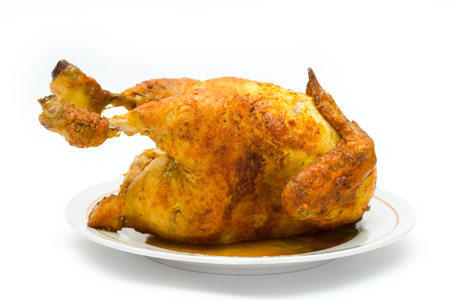 spit: The chicken fried on a spit on a white background