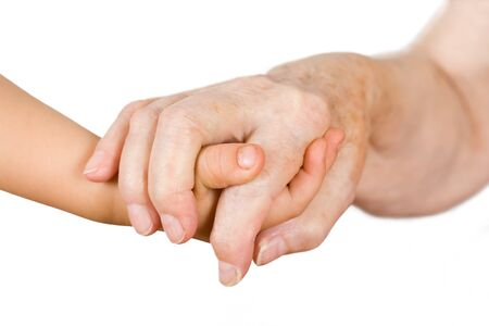 Hands of the girl and the grandmother on an isolated background Stock Photo - 1480929