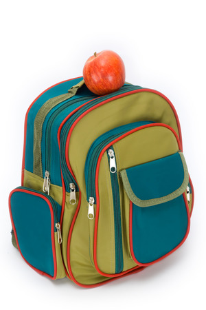 apple sack: The backpack of the schoolboy filled with a stationary