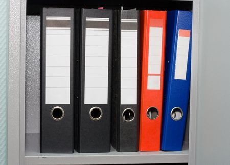 Office folders on a shelf in a case Stock Photo - 1829685