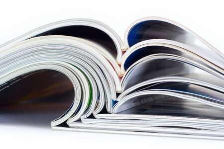 Pile of magazines on a white background photo