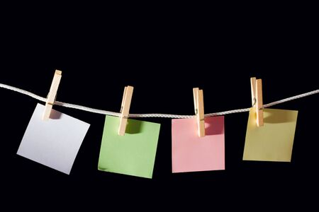 Blank memo Sheets of paper hanging on the rope photo