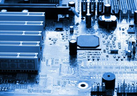 mainboard: mainboard of a computer in dark blue light Stock Photo