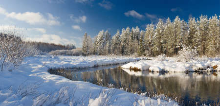 Winter landscape with the river, the blue sky and clouds Stock Photo - 2075201