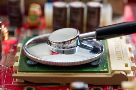 mainboard: Stethoscope on the processor of a mainboard Stock Photo