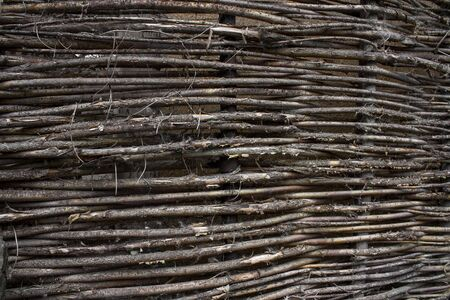 stale: stale old wicker fence made of willow twigs Stock Photo