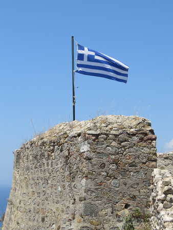 Greek flag on a bright pure blue sky background Stock Photo