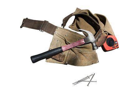 een instrument riem met een hamer, wat spijkers en een meetlint