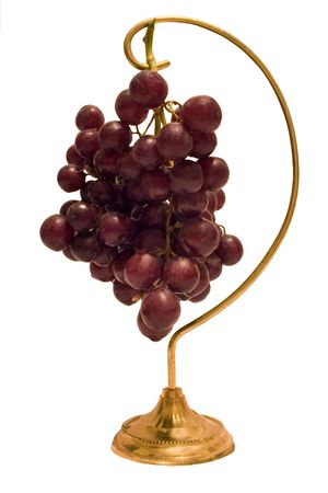 a cluster of grapes hanging on a holder photo