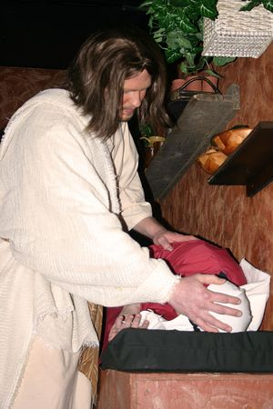 healed: Jesus laying his hands on a sick woman