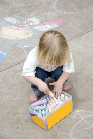 babysit: a little girl playing with sidewalk chalk
