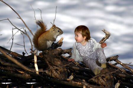 a little girl sitting with a squirrel