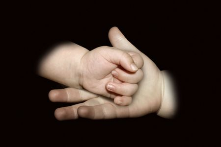 influential: A child holding a babies hand