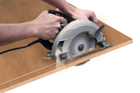 someone cutting a board with a circular saw
