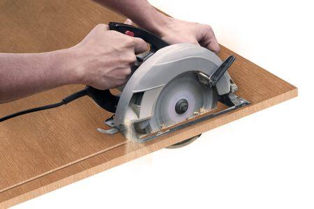 Iemand het snijden van een karton met een circulaire zagen Stockfoto - 434276