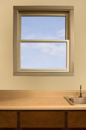 boring frame: a kitchen window over an empty counter top Stock Photo